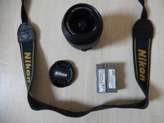 Nikon lens, battery, carrying strap and..............,