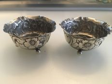 A pair of silver salts embossed decorated design of flowers ball feet - .Arthur Harris - Birmingham - circa 1906
