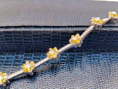 18 kt gold tennis bracelet with yellow sapphires and diamonds, with gemological certificate
