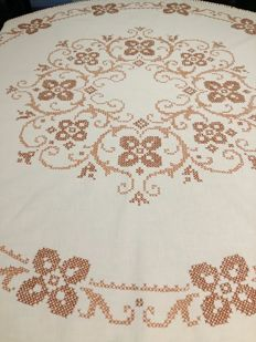 Beautiful hand-sewn round tablecloth in cross stitch.