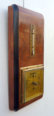 Art Deco German wall barometer with mercury thermometer from the 1930s.