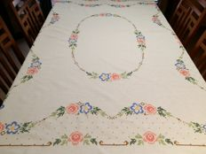 Old linen tablecloth handmade with cross-stitch technique.