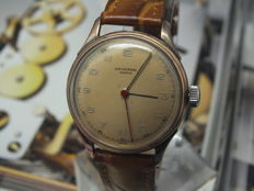 Vintage Universal Geneve gold cap manual wind