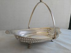 lot 638 Antique scalloped and pierced silver plated centrepiece basket with swivel handle - England, MW & W, 1950s