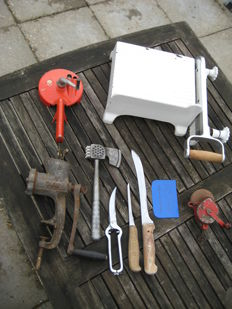 Lot of old cast iron cheese cutter, string bean mill, meat grinder, knives and hand grinding stone