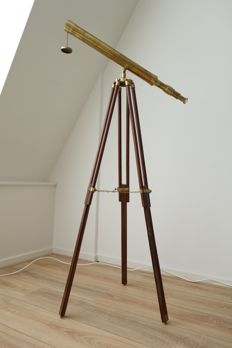 Vintage copper telescope on a beautiful wooden tripod