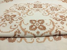 Handmade round tablecloth in cross stitch.