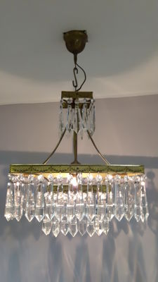 Bronze chandelier with cut glass pendalogues