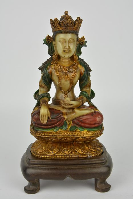 A seated, crowned Buddha - East Asia - Second half 20th century (20 cm)