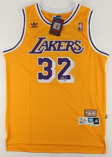 Autographed Earvin Magic Johnson Los Angeles Lakers Adidas Jersey HOF with PSA/DNA COA Autographed by NBA USA Hall of Fame.