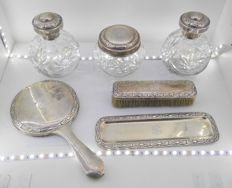 Dressing table set in punched Spanish silver, with hammered and phytomorphic decoration