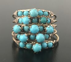 Marvellous antique so-called 'Harem' ring, in 14 kt rose gold, decorated with a cluster of cabochon turquoises