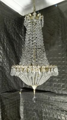 Chandelier lamp made of crystal and brass. 20th century. France