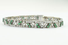 Platinum Art Deco bracelet signed and numbered with 'Cartier', set with 3.4 ct of diamonds and 40 small emeralds