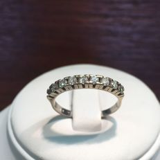 Women's ring set with a line of 9 brilliant cut diamonds - Total: 0.72 ct - Size: 19.5