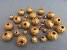 Thirty decorated gilded silver wax beads - western Himalayas - second half of the twentieth century