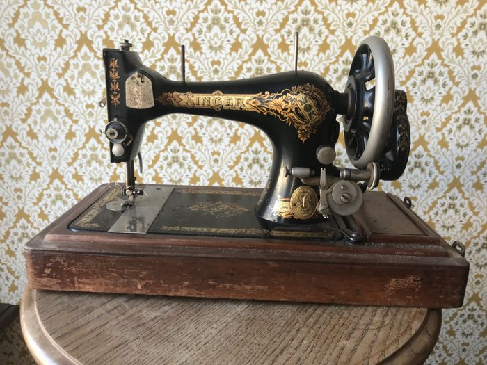 Singer 15 manual sewing machine with a wooden case, 1906