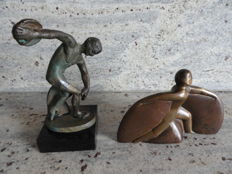 Two beautiful and unique solid bronze sculptures