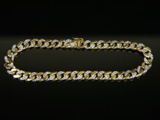 Bicoloured curb bracelet with genuine white diamonds, 0.92 ct Made of 585 white/yellow gold.