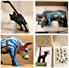 "2 artworks, Cow Parade, ""A Kids' Dream"", Rocio Picado and Alfredo Enisco, plus Parastone, ""La Flatterie the House Cat"", and her character"