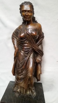 Large oak sculpture of a classical female figure