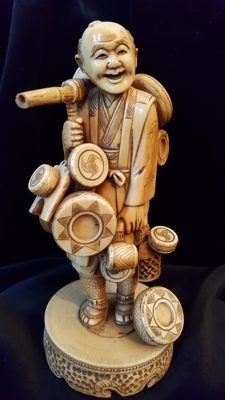 Ivory basket merchant; signed - Japan - circa 1900