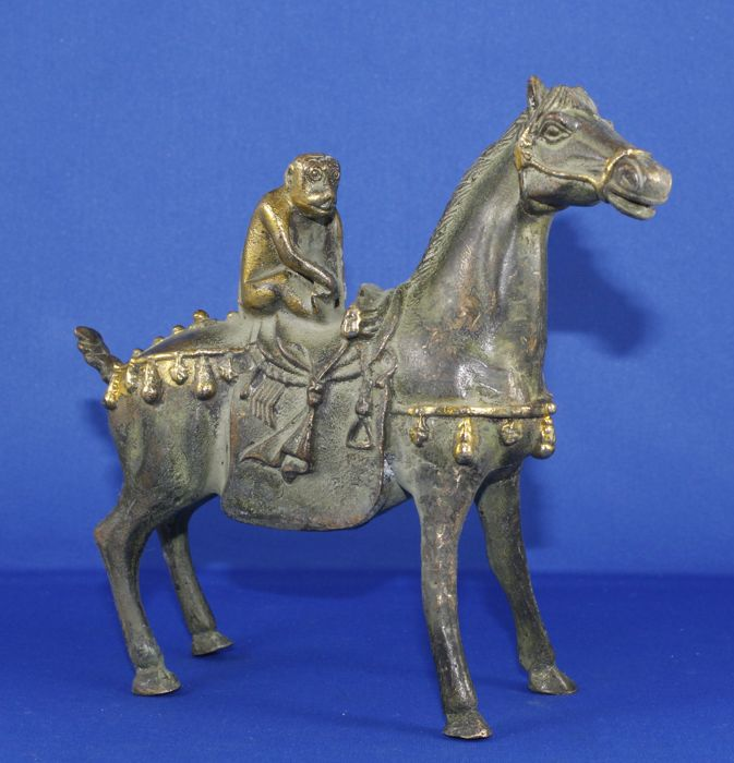 Bronze horse with monkey on its back
