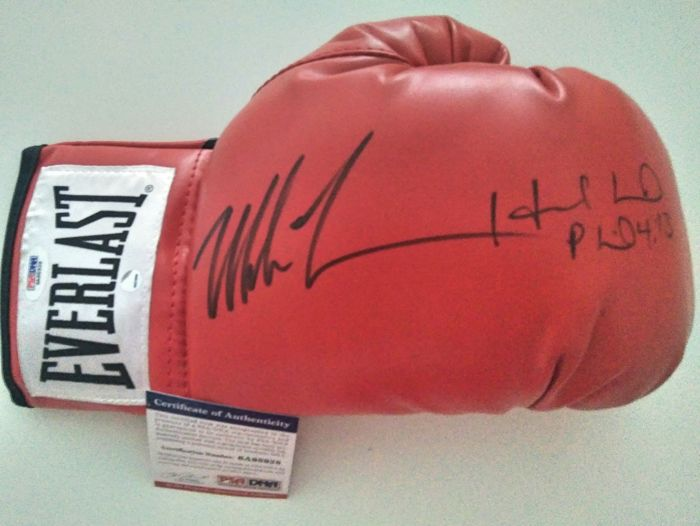 Mike Tyson and Holyfield - Red Everlast hand-signed glove with a PSA/DNA certificate and a STEINER hologram of authenticity