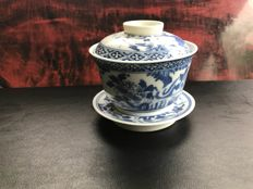 Blue and white porcelain cup and saucer - China - 19th century