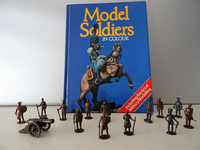 14 massive metal warriors + cannon and booklet on the art of military modelling