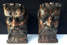 Two dated wooden head consoles, first half 20th century