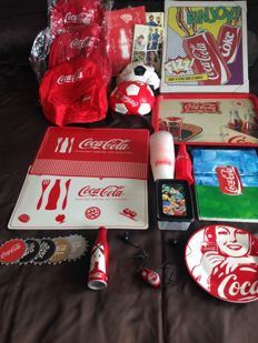 Lot of 24 products of Coca Cola of different types and periods