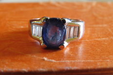Platinum ring with deep blue sapphire and diamonds