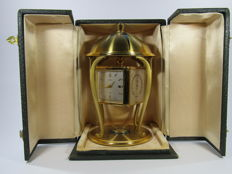 Table clock with barometer, thermometer and hygrometer functions, made by the brand Angelus circa 1960
