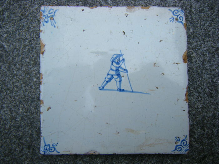 2 antique tiles depicting playing children and 2 antique tile with floral motif