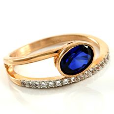 14 kt Rose Gold 1.25 ct Created Sapphire, 0.20 ct White Sapphire Ring  Size: 7 -- No Reserve
