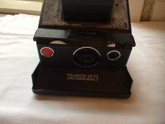 Polaroid SX-70 camera and Polaroid 636 instant camera