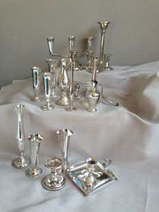 Collection of 10 silver plated candlesticks and 11 silver plated vases. 2.8 kg.