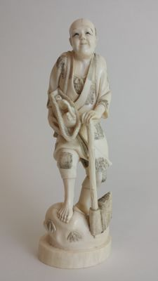 Meiji Period 19th century Japanese Ivory carving Okimono of woodcutter