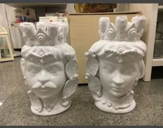 Pair of Moor Heads in the typical glossy white Caltagirone Ceramics.