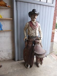 Life size statue of a cowboy