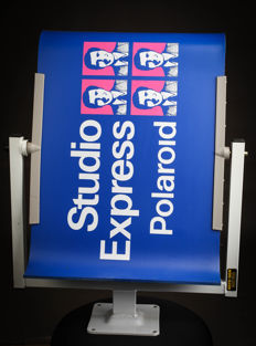 Polaroid - swivelling advertising panel  Polaroid Studio Express new
