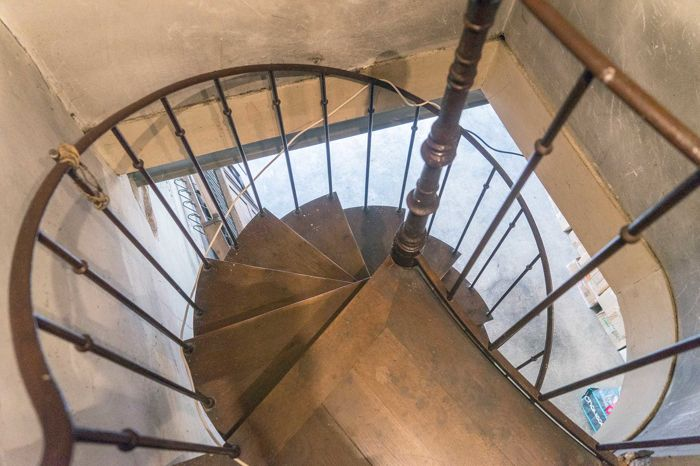 "French spiral staircase by ""B. Gilardi"" with steel frame and oak cladding from- Lyon - year 1903"