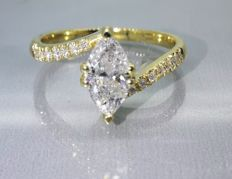 Diamond ring with marquise cut diamond of 0.75 ct & 14 diamonds - 0.90 ct in total