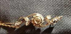 14 kt yellow gold branch brooch set with rose cut diamonds