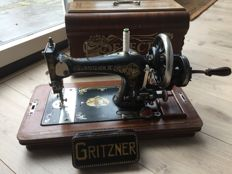 "Beautiful old antique sewing machine of the brand Gritzner ""Selecta"" with wooden case and key, Germany, ca. 1920"