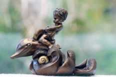Giovanni Schoeman, bronze sculpture of a boy riding a dolphin