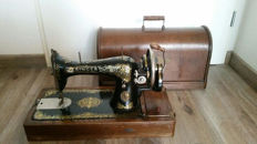 Antique Singer sewing machine including wooden cover, 1st part 20th century