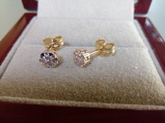 Pair of 18 kt yellow gold stud earrings and 0.23 ct of diamonds