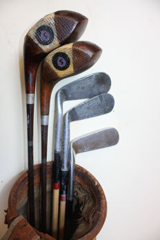 A  Collectable Early Spalding Pyratone coated golf clubs set 1927 patented in a old canvas bag